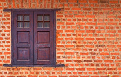 Vintage window on Red brick wall background Stock Photo