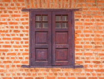 Vintage window on Red brick wall background Stock Photos