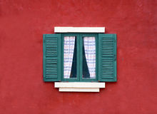 Vintage window on red cement wall Royalty Free Stock Images