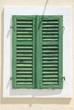 Vintage window with shutters over white wall Stock Photography