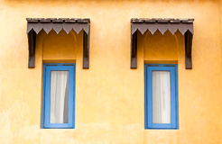 Vintage window on yellow cement wall Stock Photography