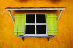 Vintage window on yellow cement wall can be used for background. Royalty Free Stock Photos