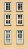 Vintage window on yellow wall Stock Image