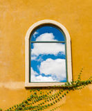 Vintage window on yellow wall Royalty Free Stock Image