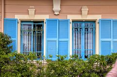 Vintage windows with blue shutters in old house, Provence, Franc. E royalty free stock image