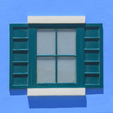 Vintage windows on the blue wall Royalty Free Stock Photo