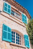 Vintage windows of the building. With wooden shutters open to sunlight - sea view royalty free stock photo