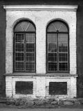 Vintage windows with lattices. Windows with lattices  in an abandoned complex, monochrome image Stock Photos