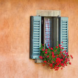 Vintage windows with open wooden shutters. And fresh flowers Stock Photos