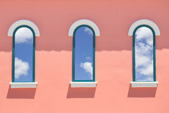 Vintage windows on the pink wall. Background Stock Photography