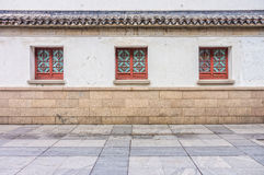 The vintage windows, roof, concrete wall and pavement Stock Image