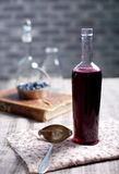 Vintage wine bottle with homemade blackcurrant, blueberry and blackberry vinegar. Old, vintage wine bottle with homemade blackcurrant, blueberry and blackberry stock images