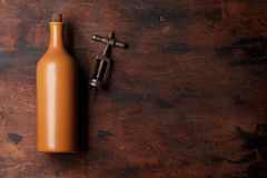 Vintage wine bottle. And old corkscrew on wooden table. Top view with space for your text royalty free stock images