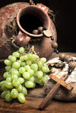 Vintage wine and broken bread Royalty Free Stock Images