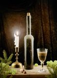 Vintage wine and candle in Christmas Stock Photography