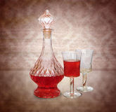 Vintage wine decanter and two glasses Royalty Free Stock Photo