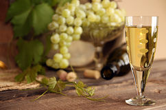Vintage wine glass against background bunch of grapes and wine b Royalty Free Stock Photo