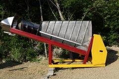 Vintage winemaking screw conveyor. In a park Royalty Free Stock Images
