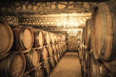 Vintage winery cellar with wine barrels. In underground winery royalty free stock photo