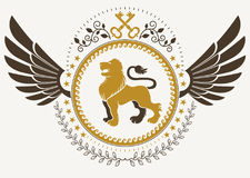 Vintage winged emblem created in vector heraldic design and comp Stock Images