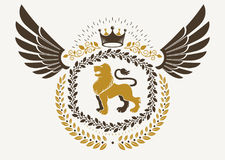 Vintage winged emblem created in vector heraldic design and comp Royalty Free Stock Images