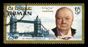 Vintage Winston Churchill Postage Stamp from Ajman. AJMAN, CIRCA 1966 - A vintage postage stamp from Ajman commemorating the life of former British Prime royalty free stock images