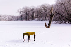 Vintage winter chair for winter fishing on lake Royalty Free Stock Photo
