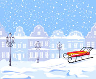 Vintage winter city and sled Stock Images