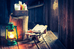 Vintage winter cottage with small wooden sleigh Royalty Free Stock Images