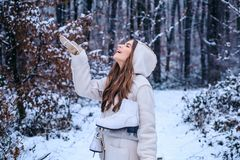 Vintage winter person. Models having fun in winter park. Global cooling. Winter portrait of young woman in the winter royalty free stock photography