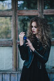 Vintage witch with elixir in hand Royalty Free Stock Photo