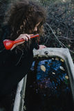 Vintage witch with elixir in hand Stock Photos