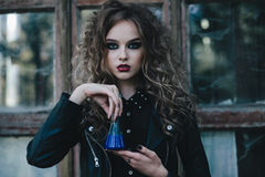Vintage witch with elixir in hand Royalty Free Stock Photos