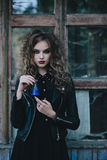 Vintage witch with elixir in hand Royalty Free Stock Images