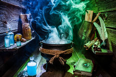 Vintage witch pot with blue and green smoke for Halloween royalty free stock photography
