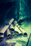 Vintage witch workshop with green light and scrolls for Halloween royalty free stock images