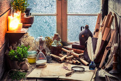 Vintage witch workshop with scrolls and ingredients stock photography