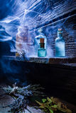 Vintage witcher cottage with blue magic potion for Halloween Stock Image