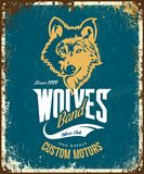 Vintage wolf custom motors club t-shirt vector logo on blue background.  Royalty Free Stock Images