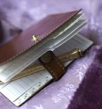 Vintage woman adress book. Small adress book with old gold pencil Royalty Free Stock Image