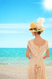 Vintage woman at the beach Stock Image