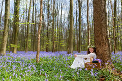 Vintage woman in bluebells forest Royalty Free Stock Photo