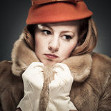 Vintage Woman Clutching Her Faux Fur Coat Royalty Free Stock Photography
