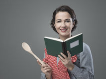 Vintage woman with cookbook Stock Photos
