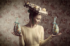 Vintage woman with easter eggs Stock Images