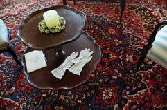 Vintage woman gloves & wedding souvenir Royalty Free Stock Photos