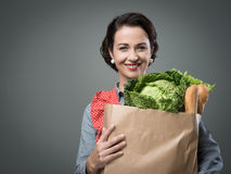 Vintage woman with grocery bag Royalty Free Stock Photo