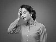 Vintage woman with headache Stock Image