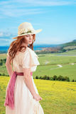 Vintage woman on a hill over looking seaside town. Portrait of vintage woman on a hill over looking seaside town Stock Image