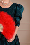 Vintage woman holding red feather fan Royalty Free Stock Photos